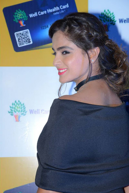 Asmita Sood Latest Hot Cleveage Spicy Black Trendy Skirt PhotoShoot Images At Well Care Health Card Launch