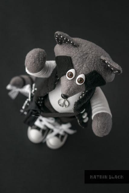 Енот - игрушка ручной работы.