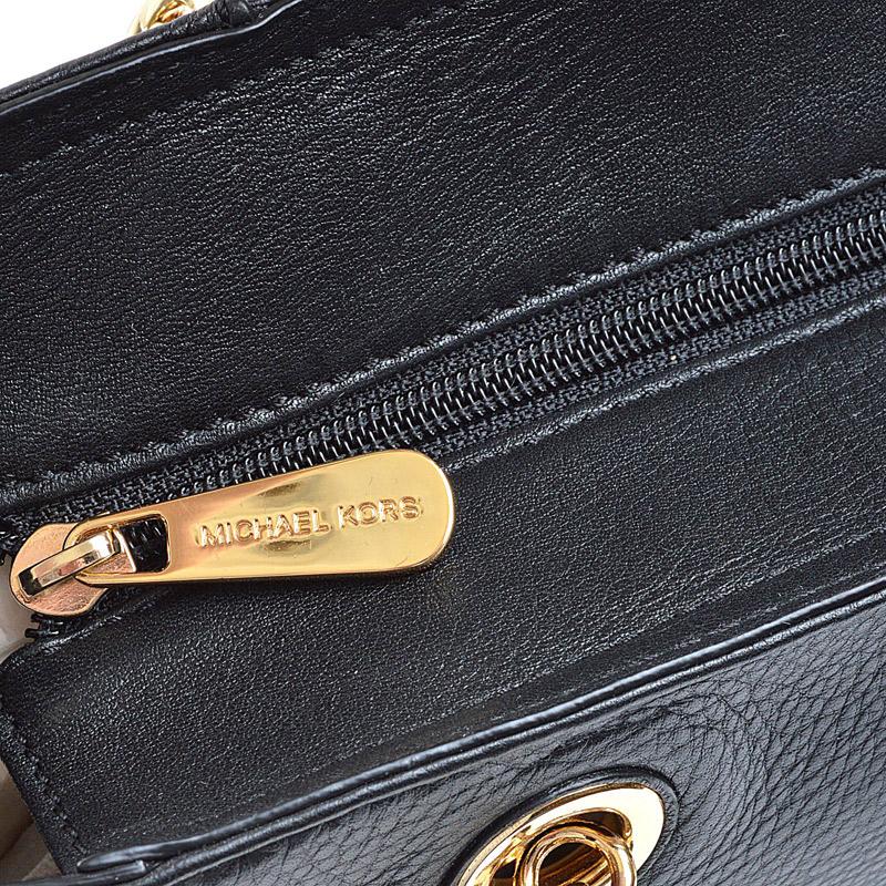 Como reconocer una bolsa Michael Kors original 2ce8b8992b