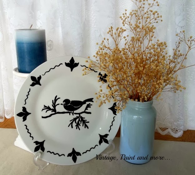 right facing display of completed plate with a candle and jar of flowers