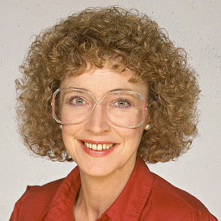 Dierdre Barlow 80s perm and glasses
