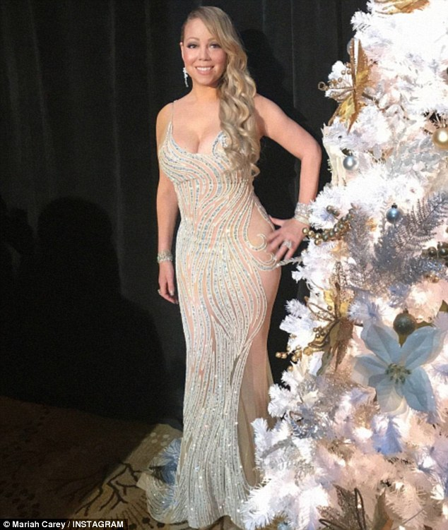 Mariah Carey is glittering in floor length gown