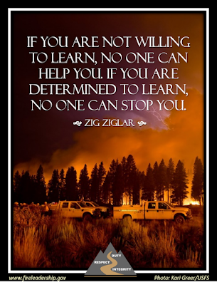 If you are not willing to learn, no one can help you. If you are determined to learn, no one can stop you. - Zig Ziglar (wildland fire in background with trees and trucks in the front)