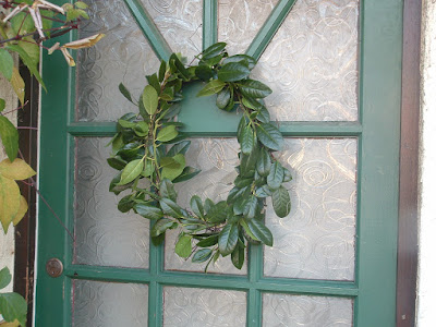 A simple holly wreath on a front door