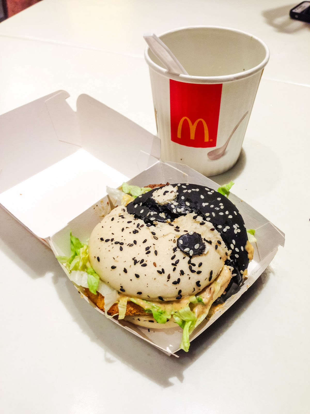 http://www.thatfoodcray.com/2013/05/31/mcdonalds-cray-black-white-burger/