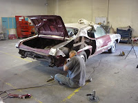 Master Body Technician Bob Gibbs works on a 1970 Pontiac GTO Judge