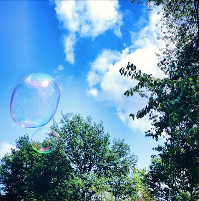 Summer days in the garden at De Tout Coeur Limousin - blowing bubbles
