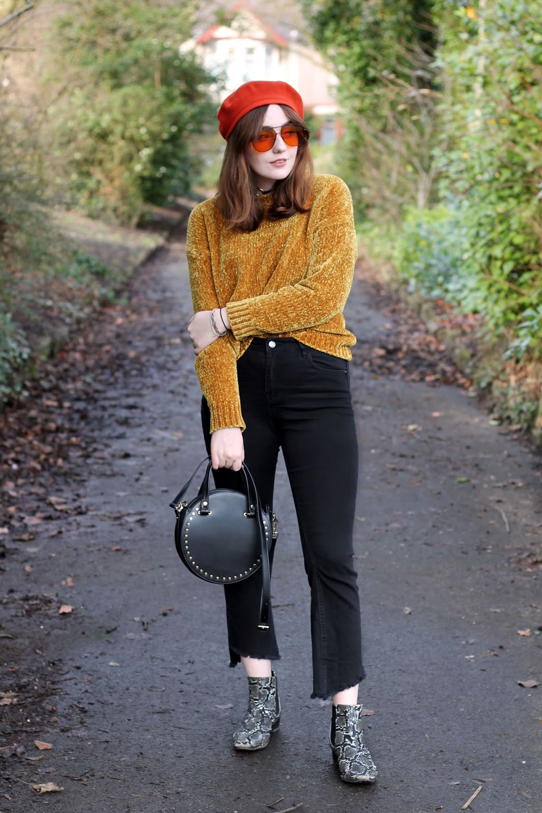 mustard chenille jumper, orange beret and 70s sunglasses, black round topshop bag, black kick flare jeans and snake print boots on Liverpool fashion blogger