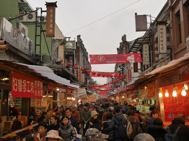 dense crowd at the Taipei Lunar New Year Festival on Dihua Street