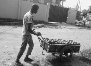 https://commons.wikimedia.org/wiki/File:Meruwa_Malam_-Truck_Pusher_Selling_Water_on_the_Street_at_Somolu_Lagos_Nigeria.jpg