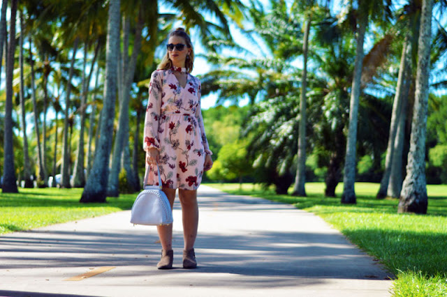 girl wearing blush floral dress with pastel grey oliver bilou bag and boots