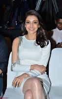 Beautiful Smiling Kajal Aggarwal in Creamy White Gown at MLA Telugu Movie Success Meet ~ .com Exclusive Pics 009.jpg