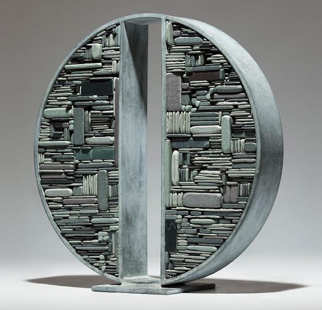 """هذه الصورة تدعى """"إنقسام متروبوليس"""" لفنان يدعى """"توم ستوج دون"""""""