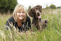 A woman and her dog in a meadow
