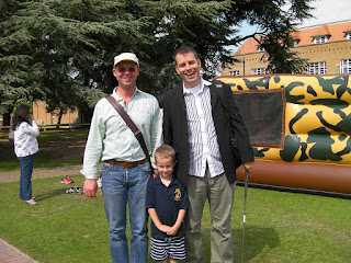 Bune and Jason by the bouncy castle and the merchant taylors school design and technology block