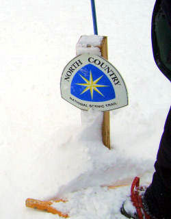 North Country Trail sign in snow