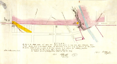Map showing the southern extent of Lot C, Concession C as it adjoins the Sparks Street property, between Bank Street and Rideau Street. The southern boundary of the Ordnance (government) property on Barrack Hill takes up nearly the entire width of the erstwhile Wellington Street alignment. The existing narrow road is shown in context with the subdivided block at the southeast corner of Bank and Wellington, and a new, wider, road is drawn connecting the opposite corners of this block, so as to connect Wellington with Sparks.
