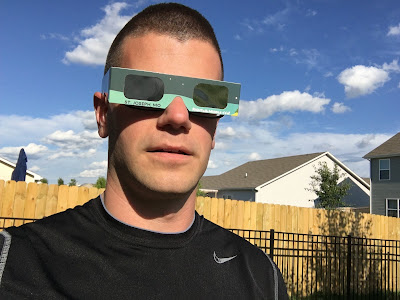 front view eclipse glasses over regular glasses