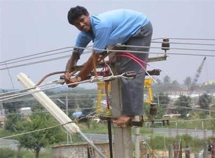 Man works on electric cables