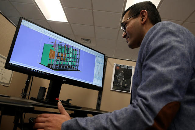 Image Attribute: Product Development Engineer Jigar Patel works with a CAD image of a thrust reverser cascade in development at Oxford Performance Materials Inc., the maker of more than 600 parts to be used on Boeing's new Starliner manned spacecraft, in South Windsor, Connecticut, the maker of more than 600 parts to be used on Boeing's new Starliner manned spacecraft, in South Windsor, Connecticut, U.S., January 31, 2017. REUTERS/Mike Segar