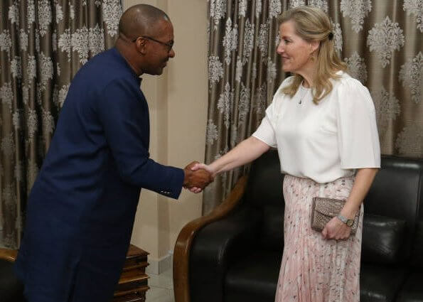The Countess met with the mayor of Freetown Yvonne Aki-Sawyerr and President Dr. Mohamed Juldeh. floral print blouse and green midi dress