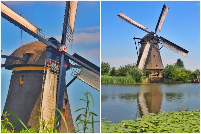 Molino holandes, sus aspas y canal en Kinderdijk en los Paises Bajos