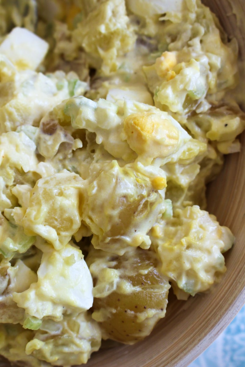 Mom's Traditional Potato Salad is a classic potato salad that is creamy and delicious, made with mayo, mustard, onion, celery, and hard-boiled eggs.  It is the perfect side dish for cookouts, picnics, potlucks, and parties! #potatosalad #sidedish