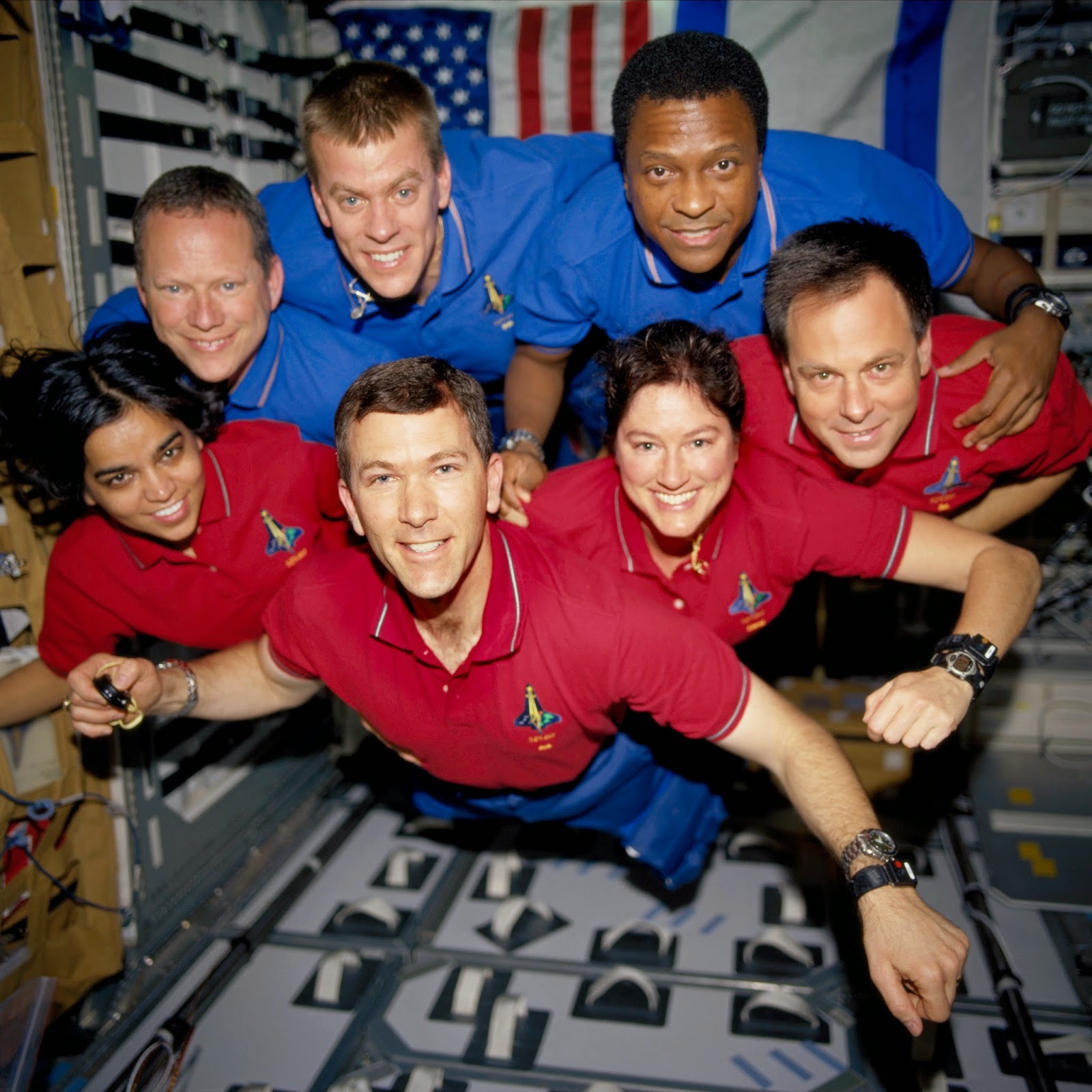 The STS-107 crewmembers strike a 'flying' pose for their traditional in-flight crew portrait in the SPACEHAB Research Double Module (RDM) aboard the Space Shuttle Columbia. From the left (bottom row), wearing red shirts to signify their shift's color, are astronauts Kalpana Chawla, mission specialist; Rick D. Husband, mission commander; Laurel B. Clark, mission specialist; and Ilan Ramon, payload specialist. From the left (top row), wearing blue shirts, are astronauts David M. Brown, mission specialist; William C. McCool, pilot; and Michael P. Anderson, payload commander. Ramon represents the Israeli Space Agency. Credit: NASA