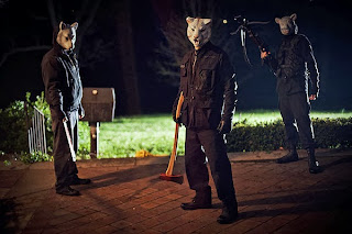 Lamb mask (L C Holt), Fox mask (Lane Hughes) and Tiger mask (Simon Barrett) in Youre Next movie review slasher horror