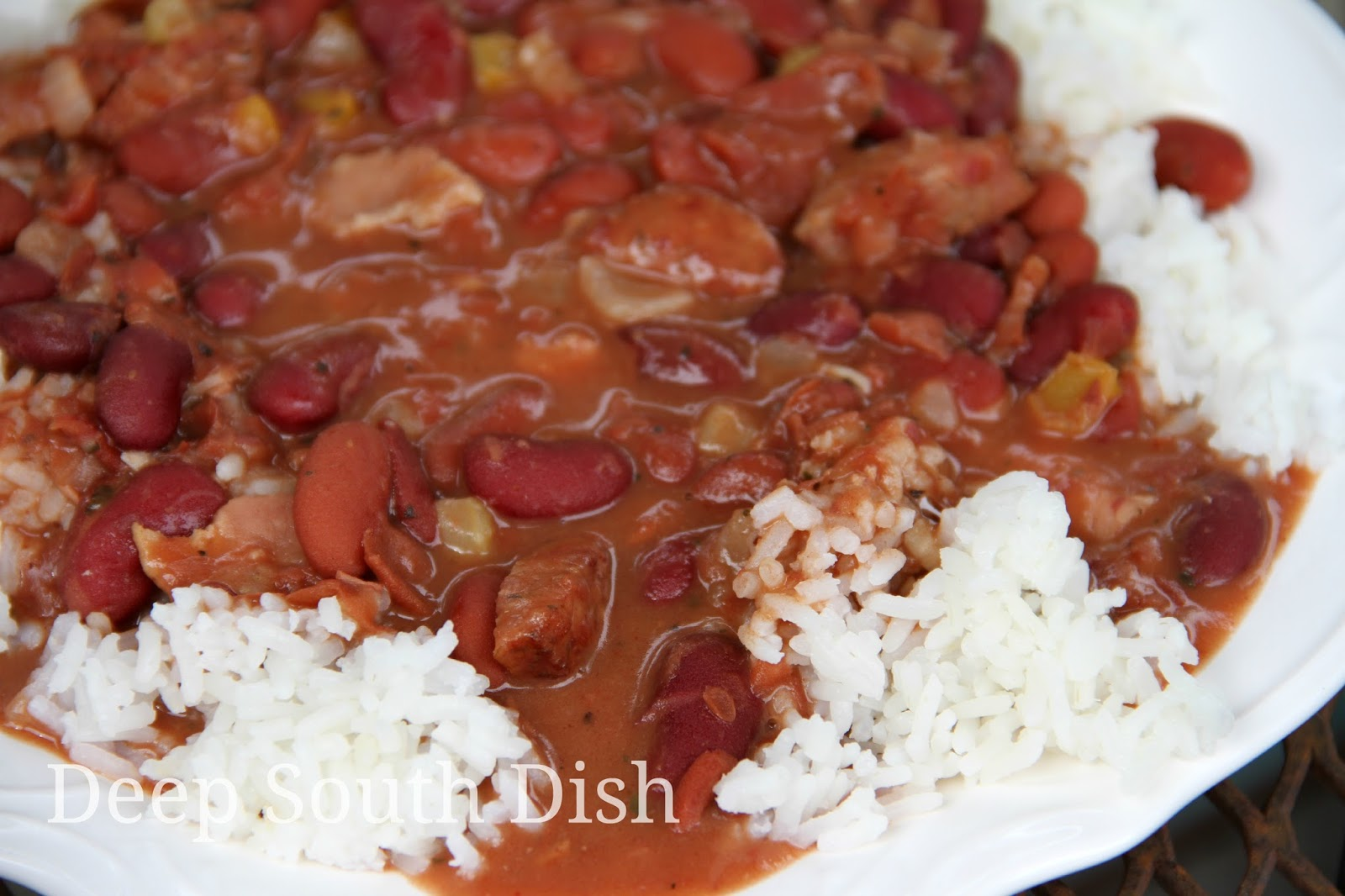 A quicker version of Red Beans and Rice made with The Trinity, bacon, smoked sausage and canned kidney beans, preferably Blue Runner brand. You will hardly believe they're a shortcut version!