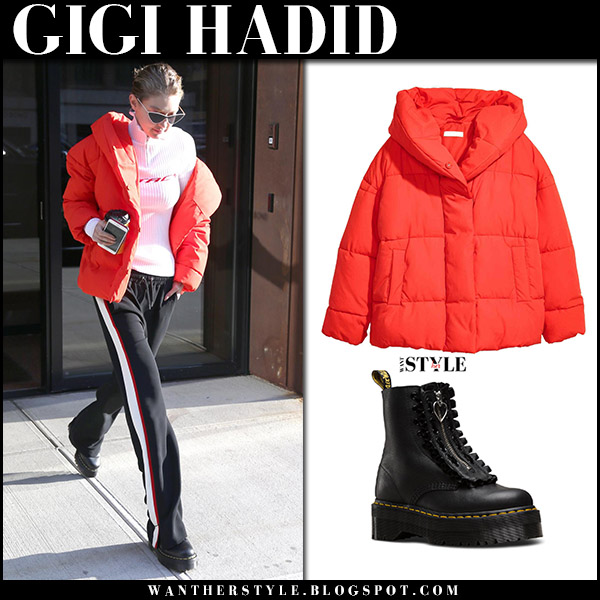 Gigi Hadid in red padded jacket h&m, black pants and ankle boots dr. martens in NYC november 14 2017 street winter fashion