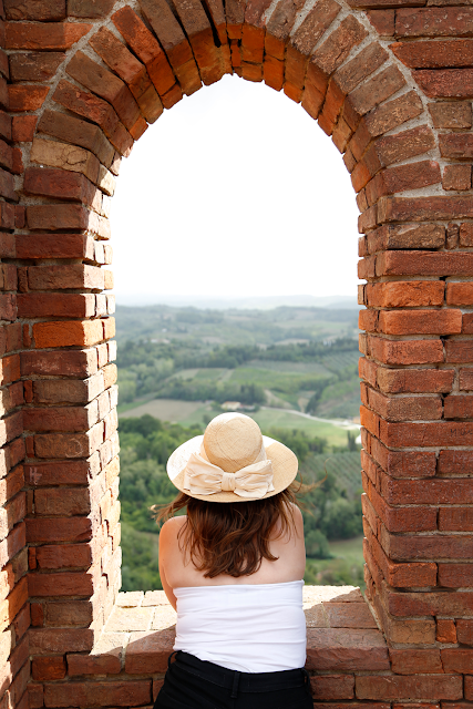 Katy in Hat Looking Over View of San Miniato Countryside from Rocco Tower, Tuscany, Italy