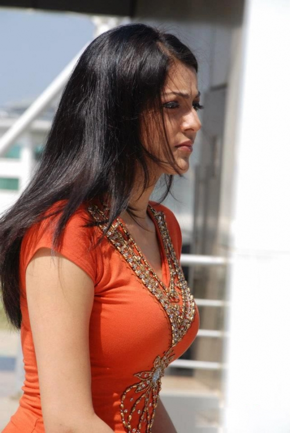 South Indian Hot Actress Kajal Agarwal Sad looking Stills In Orange Dress