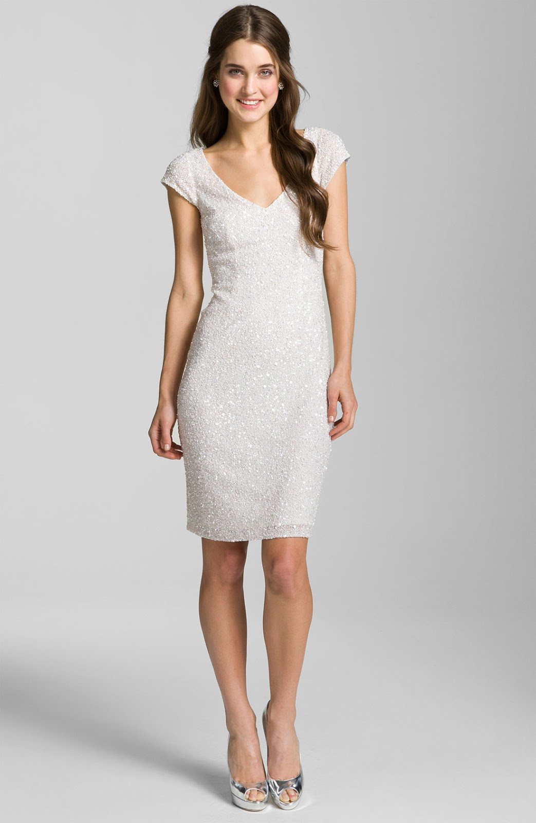 A sheath dress features a silhouette that fits close to the body and can have a hemline that hits anywhere from mid-thigh to mid-calf. A sheath by definition (think about the sheath of a sword, for example) is meant to hold close to that which it encases.