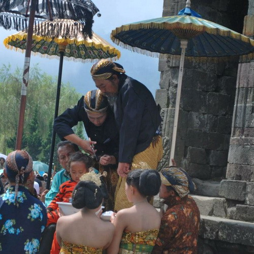 Tinuku Travel Dieng Culture Festival, exotic cultural event people in Arjuna temples complex on Dieng plateau each August