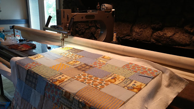 Quilting charity quilts on my new longarm