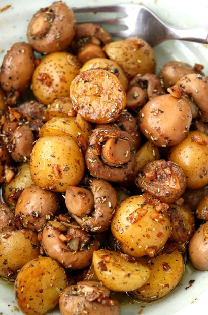 A buttery dish of pan-roasted Garlic Mushroom and Baby Potatoes with herbs. So simple and very easy to make with elegant results that make for a delicious side or appetizer.