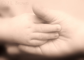 Image: Tiny hands of my wonderful grandsons, by Jimmy Brown, on Flickr