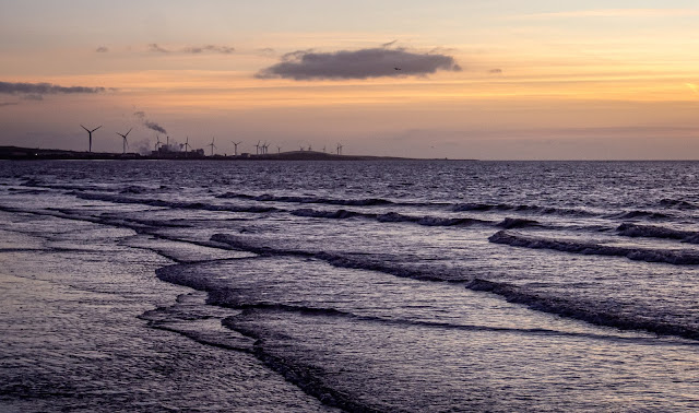 Photo of looking along the shore from Maryport towards the Iggesund paperboard factory at Workington