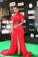 Apoorva in a Stunning Tight Leg Split Sleeveless Red Gown at IIFA Utsavam Awards 68.JPG