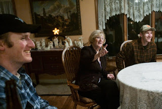Twin brothers Justin, left, and James Westers celebrate their 30th birthday Thursday with their mother, Jolie, 80, at her home in Rives Junction. Jolie was 50 when she gave birth to her ninth and 10th children in 1981.