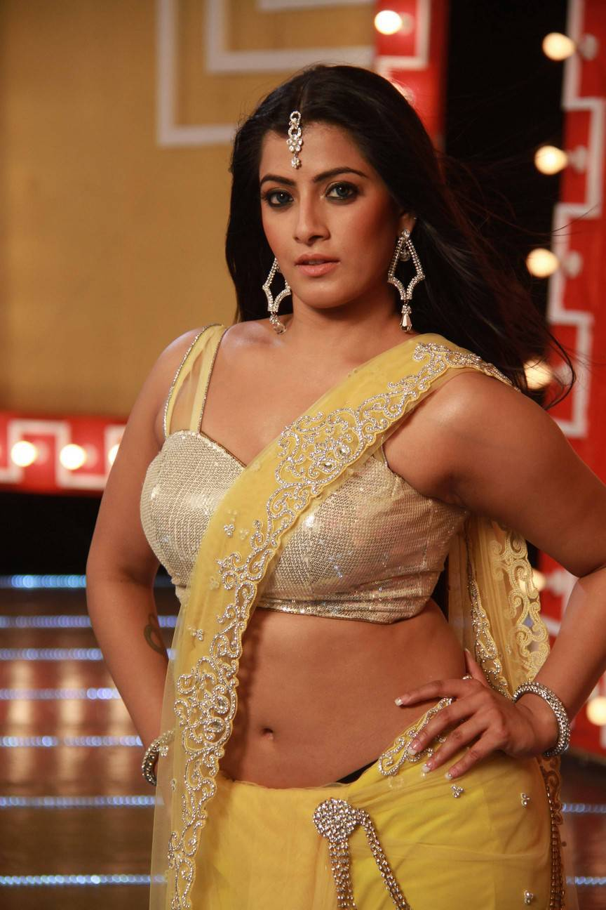 Varalaxmi Sarathkumar Navel Hip Show Photos From Tamil Movie In Yellow Saree