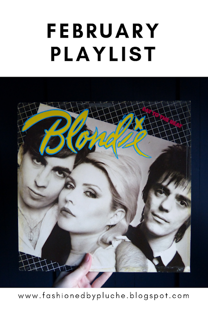 "This picture depicts someone holding up a vinyl of Blondie Eat To The Beat album. On top of the picture it states ""February Playlist"" and at the bottom ""www.fashionedbypluche.blogspot.com""."