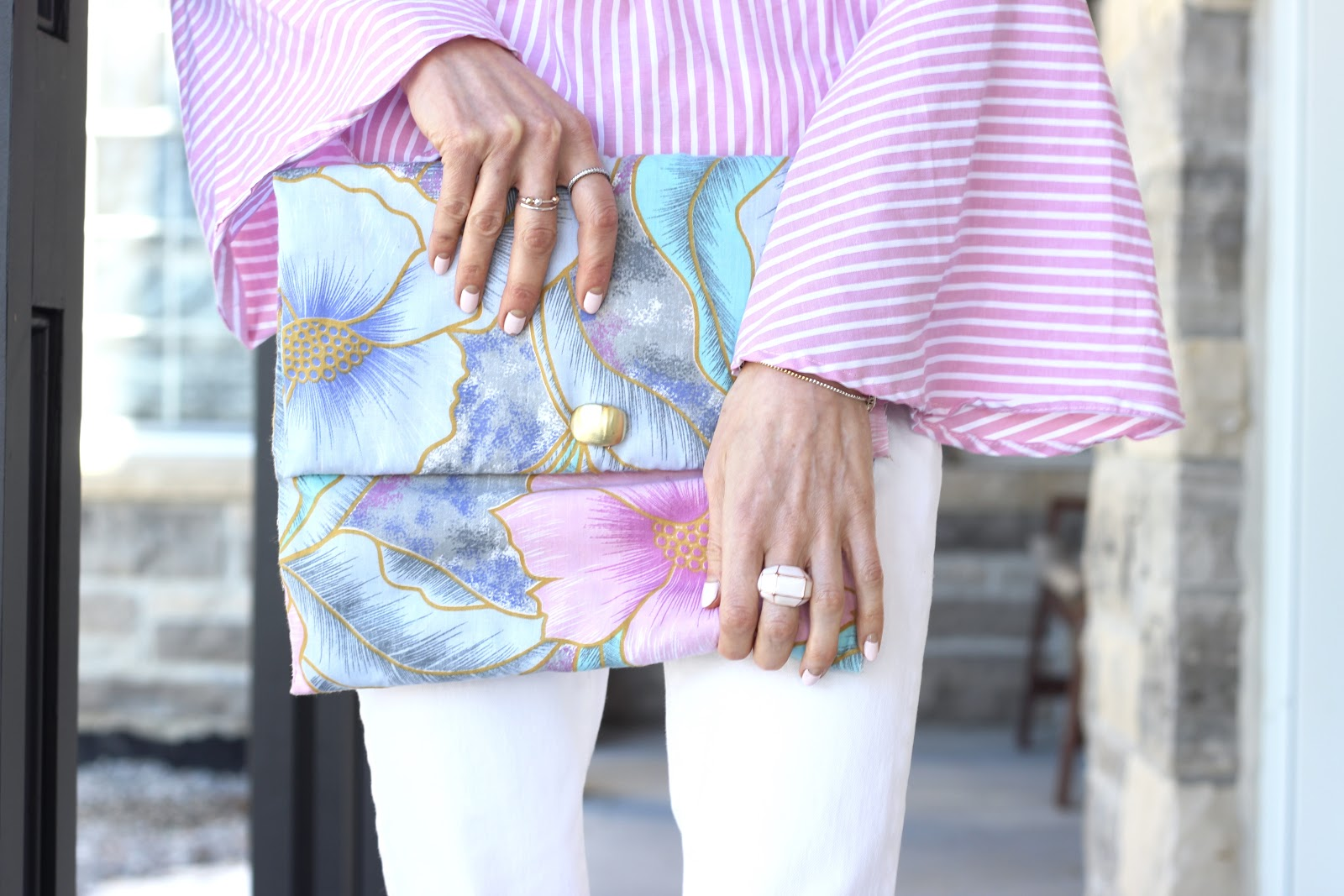 pink stripe bell sleeve blouse, white american eagle denim, zara white leather kitten heels, diy floral clutch