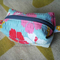 Boxy pouch with pleats