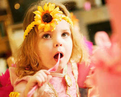 baby-decorate-her-hair-with-sunflowwer-images.jpeg
