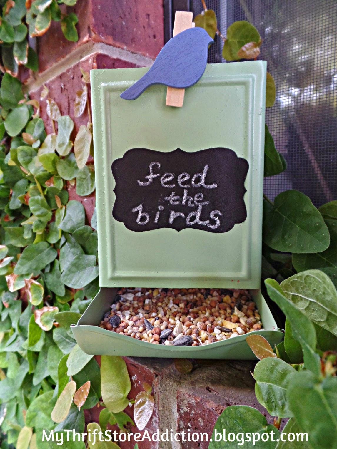 Repurposed vintage match holder bird feeder