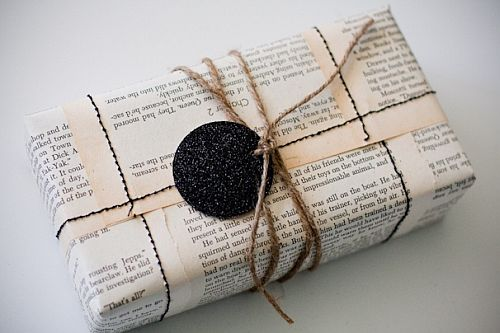 eco-friendly newspaper wrapping with glitter gift tag