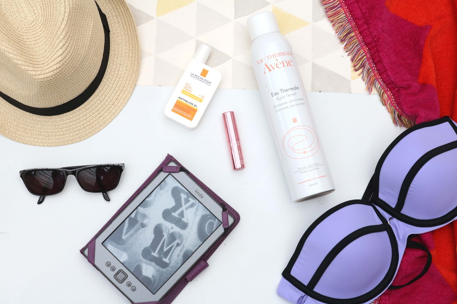 A beach day must haves, sunhat,towel, bikini, suncream, sunglasses, kindle, lip balm, cooling spray