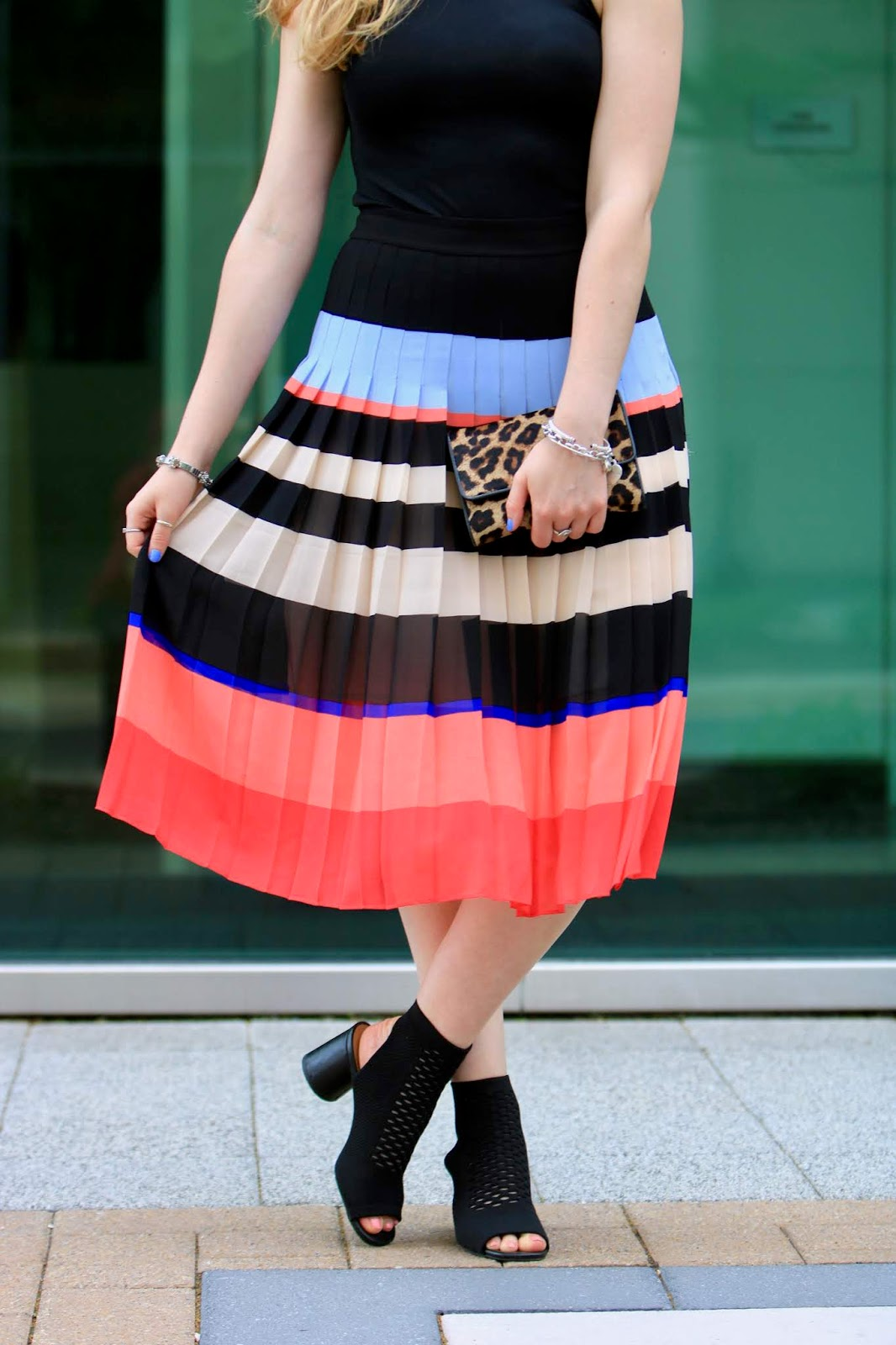 Nyc fashion blogger Kathleen Harper wearing a colorful striped midi skirt